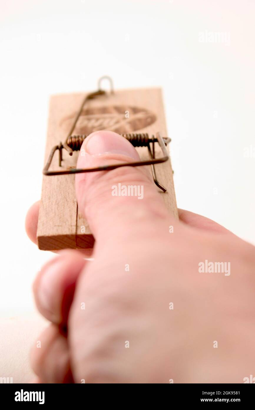 thumb in a mousetrap Stock Photo