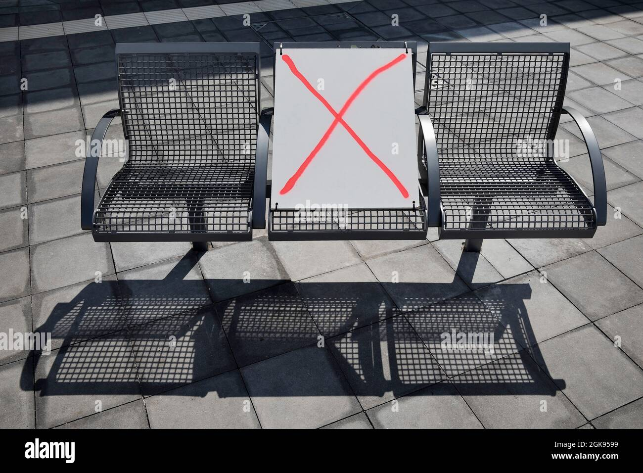 Corona-distancing regulations on a bench in spring 2021, Central bus station, Germany, Berlin Stock Photo