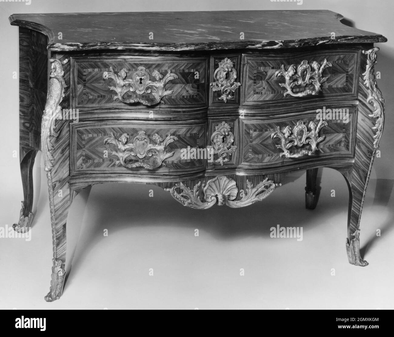 Commode. Date: ca. 1720-30; Culture: French; Medium: Various marquetry woods, marble, gilt bronze; Dimensions: Overall: 31 7/8 x 46 x 23 in. (81 x Stock Photo