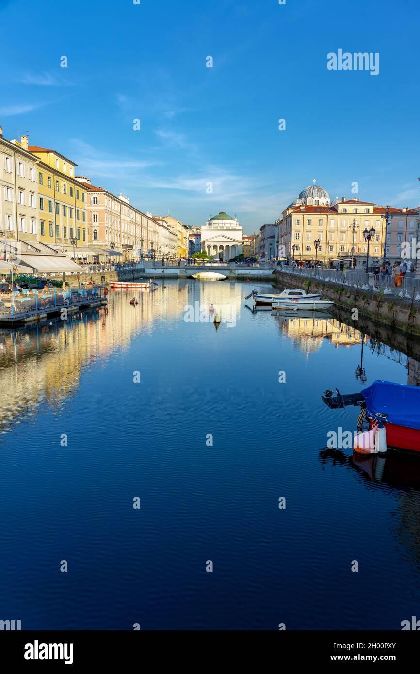 11.08.2021: Trieste, Italy: Canal Grande di Trieste with la chiesa di sant  antonio church daytime Stock Photo - Alamy