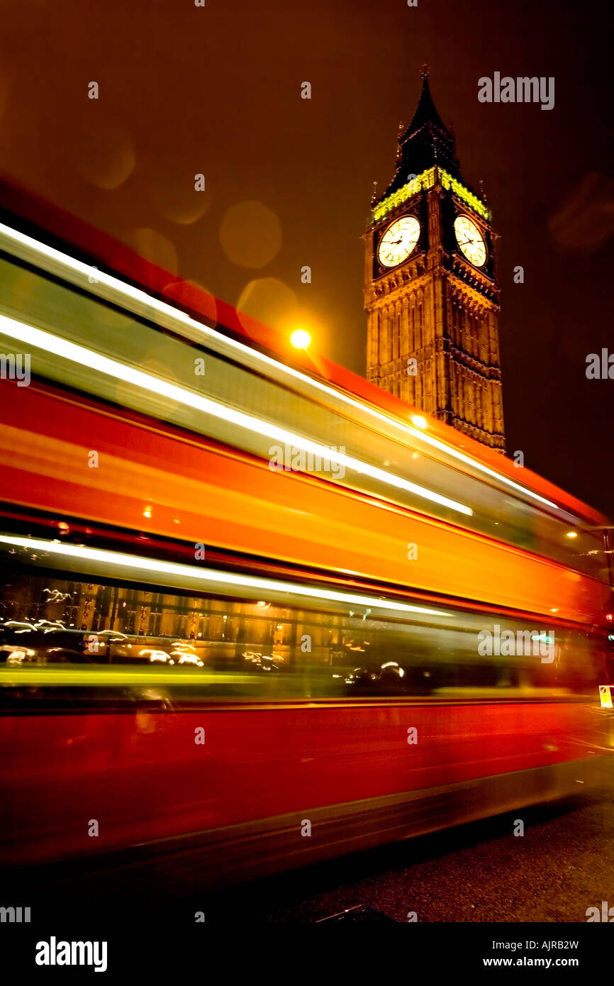 Big Ben Clock and the Houses of Parliament with Iconic London Red Bus at Rush Hour - Image AJRB2W  <div style=