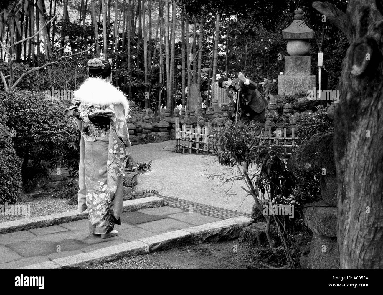 Girl celebrating adult day by being photographed at Temple in Kamakura Japan fabrik studios - Stock Image