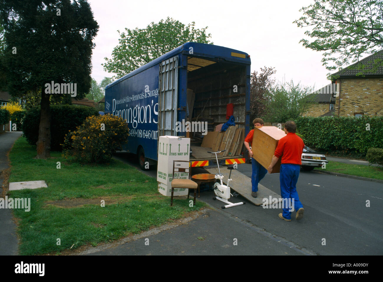 Removal Men Moving Furniture into Lorry Stock Photo
