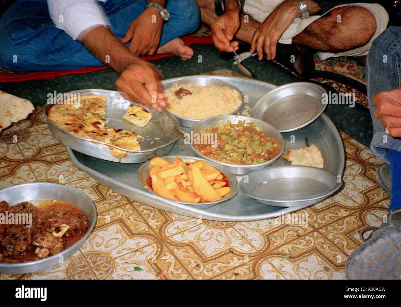 Thula Yemen Traditional Meal Being Served on a Tray on the Floor - Stock Image