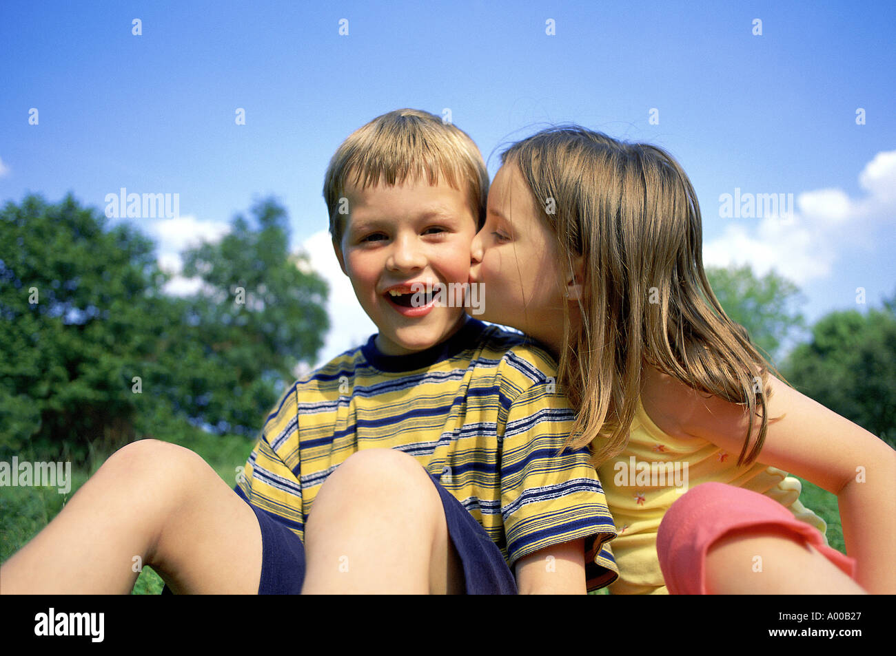Young Girl Kissing Young Boy On Cheek Stock Photo 2855 Alamy