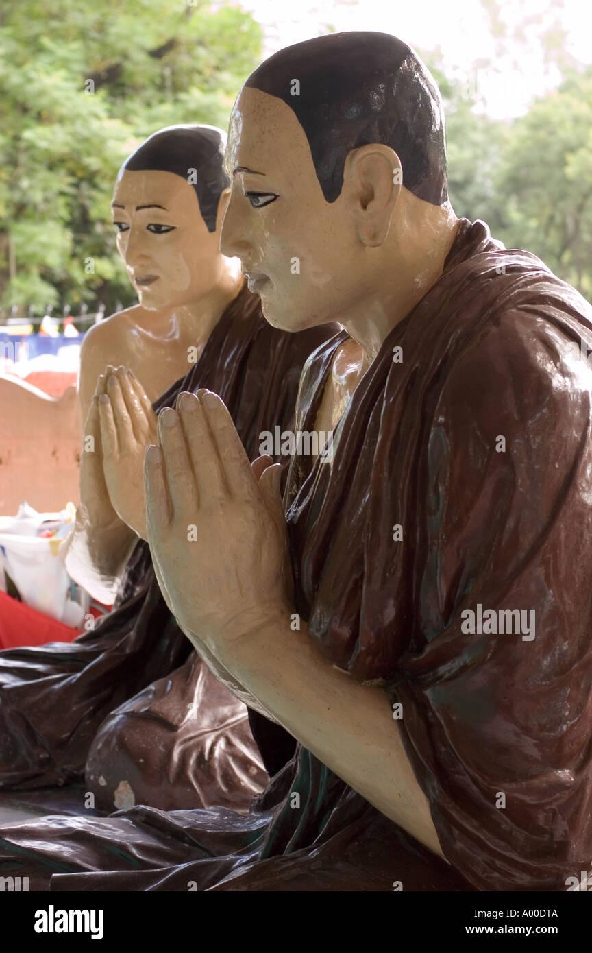 Statues showing Buddha disciple hearing first Buddha teachings in Sarnath Varanasi Bihar India - Stock Image