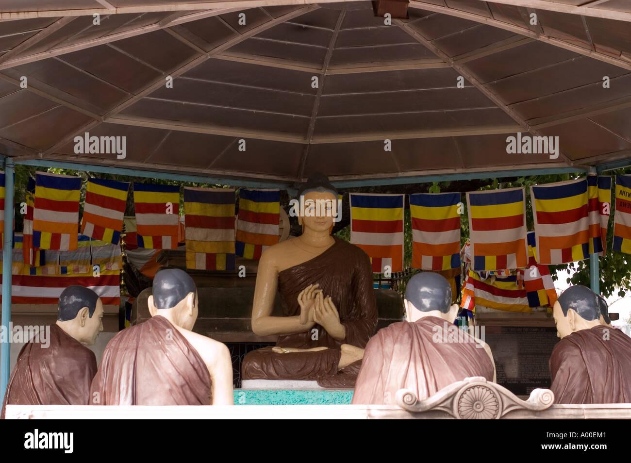 statues showing Buddha giving his first teachings in Sarnath Varanasi Bihar India - Stock Image