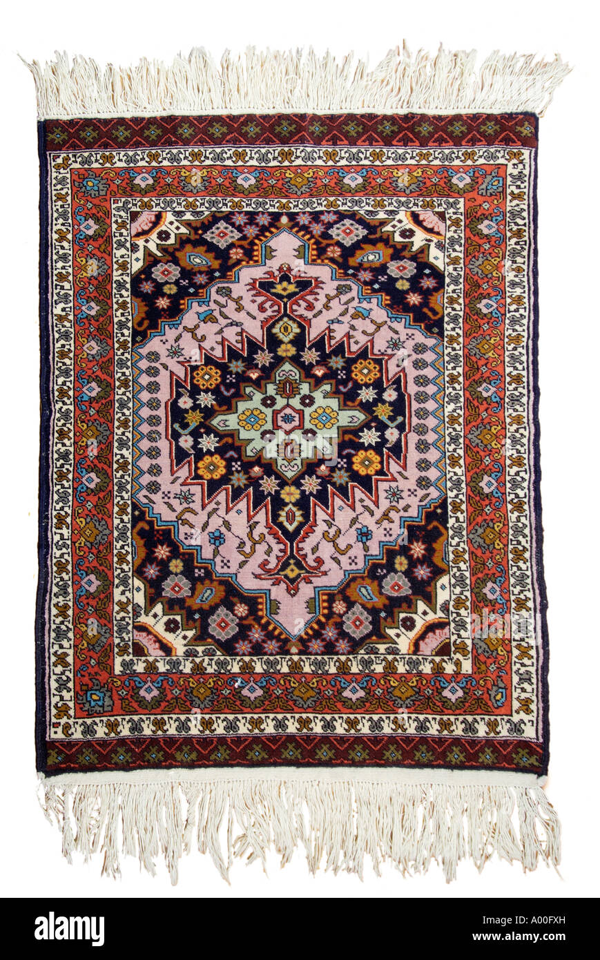 Carpet rug Iran Iranian Persia Persian near Middle East regional region Asia minor north east South west - Stock Image