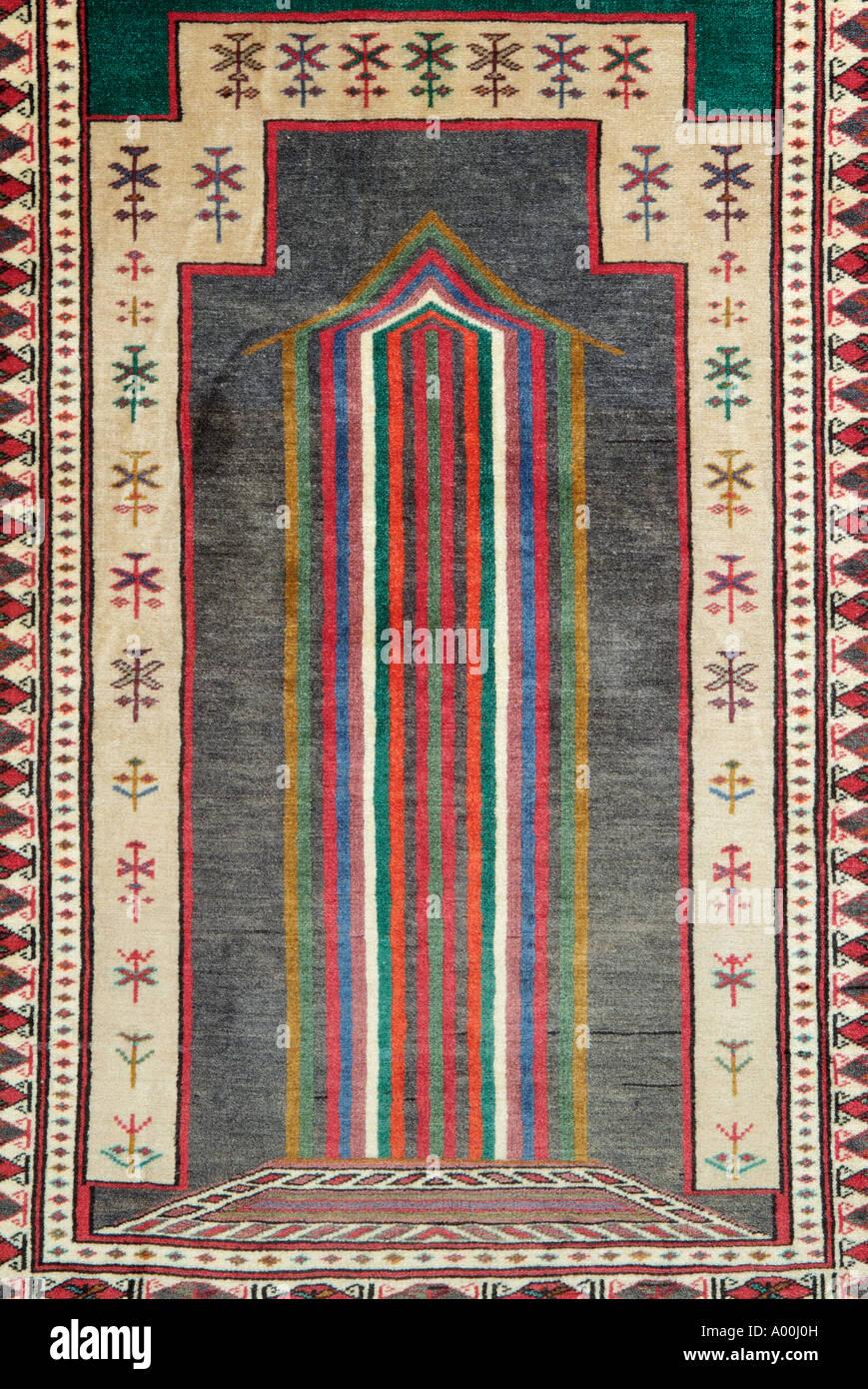 prayer religion Islam Islamic Moslem Carpet rug Iran Iranian Persia Persian near Middle East regional region Asia minor north ea - Stock Image