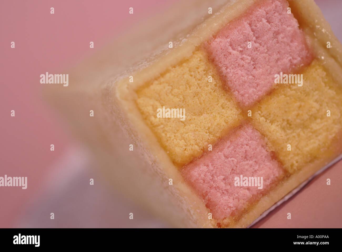 pink and yellow battenburg cake - Stock Image