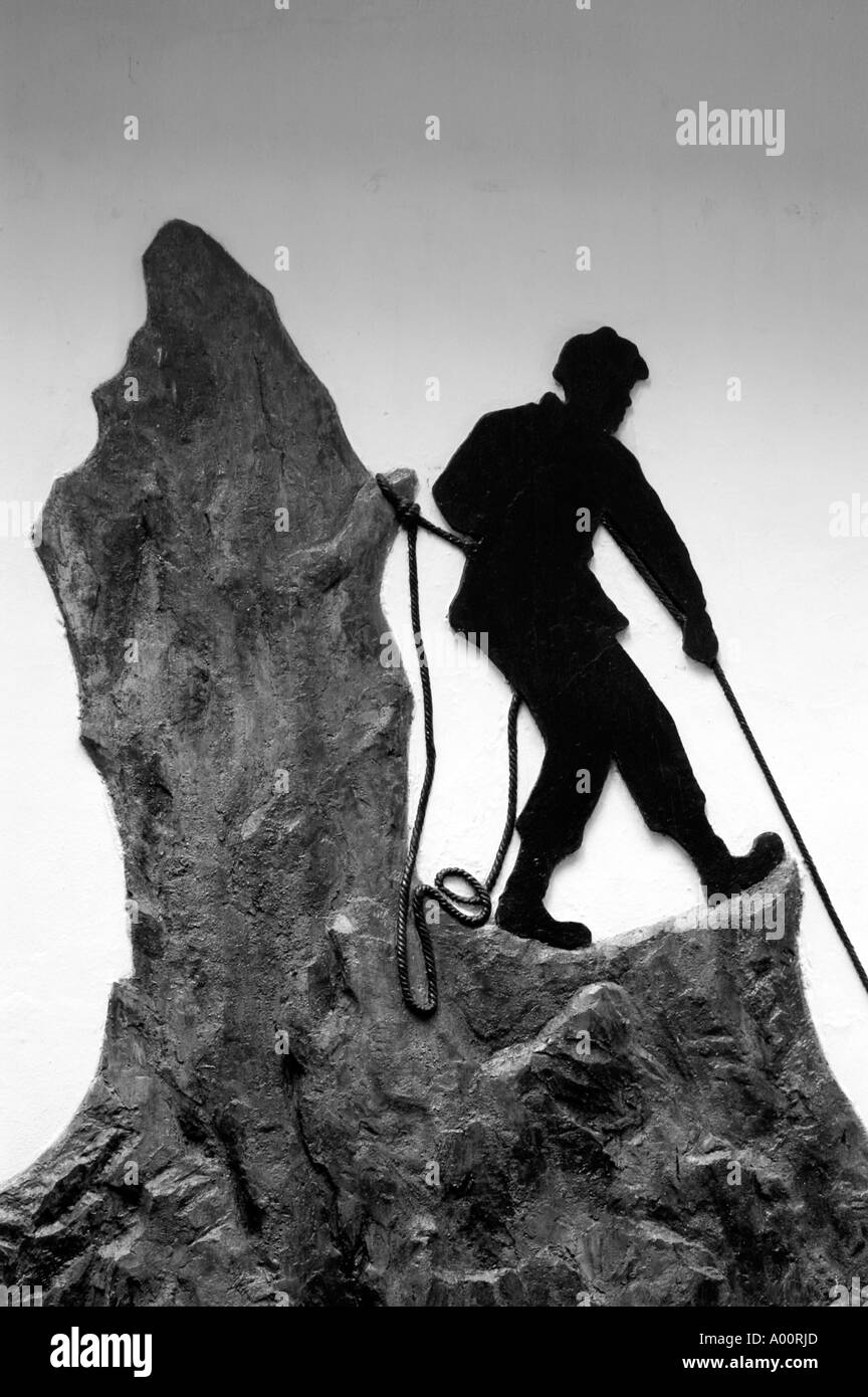 Bas relief showing Alpinist on the rock shelf Darjeeling Himalayan Mountaineering Institute West Bengal India - Stock Image