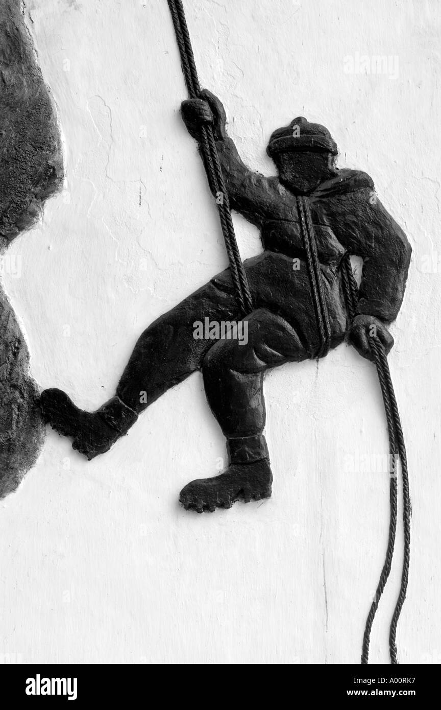 Bas relief showing Alpinist descending from rock by rope Darjeeling Himalayan Mountaineering Institute West Bengal India - Stock Image