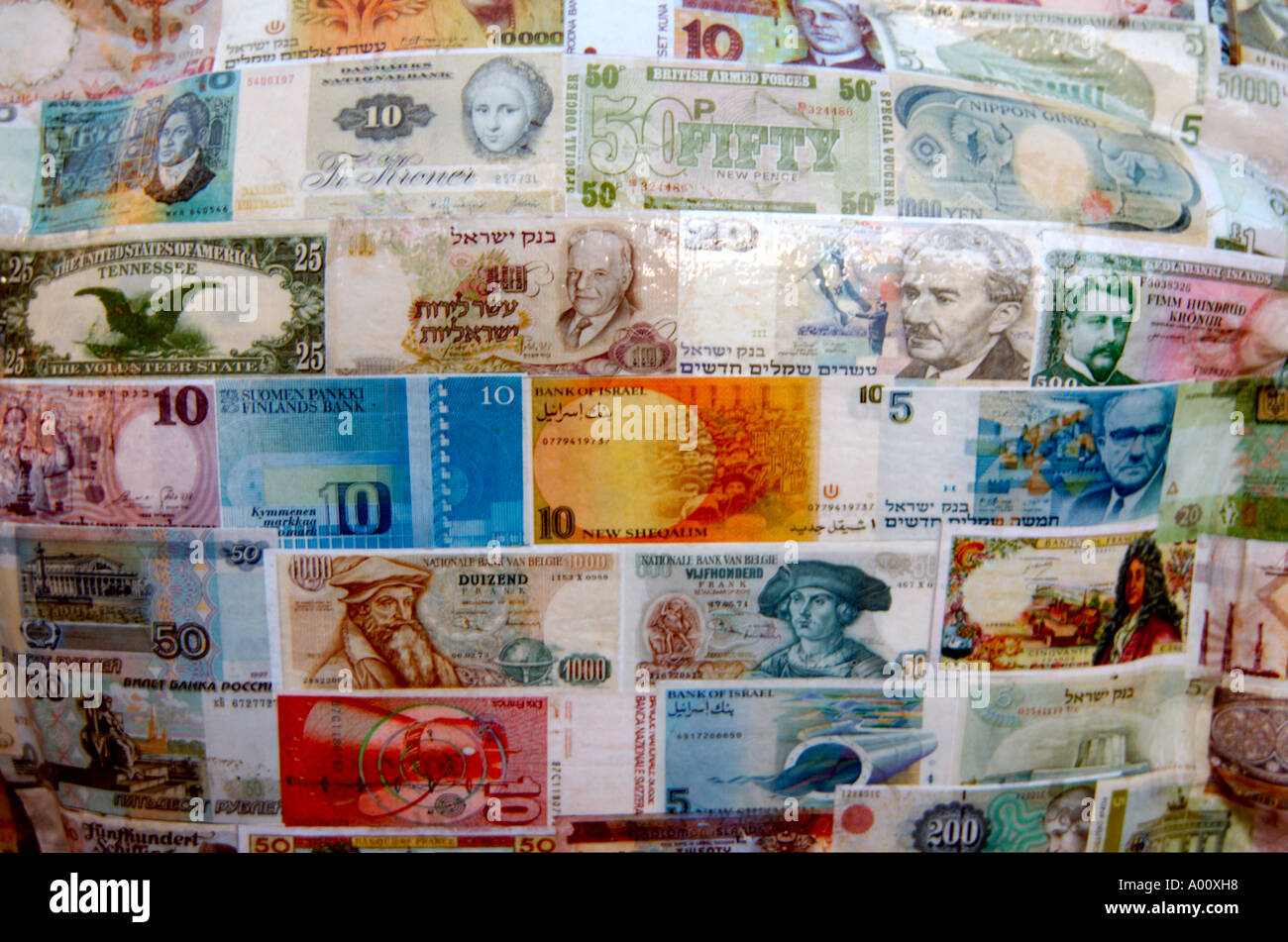 A collection of paper notes from different countries and currencies - Stock Image