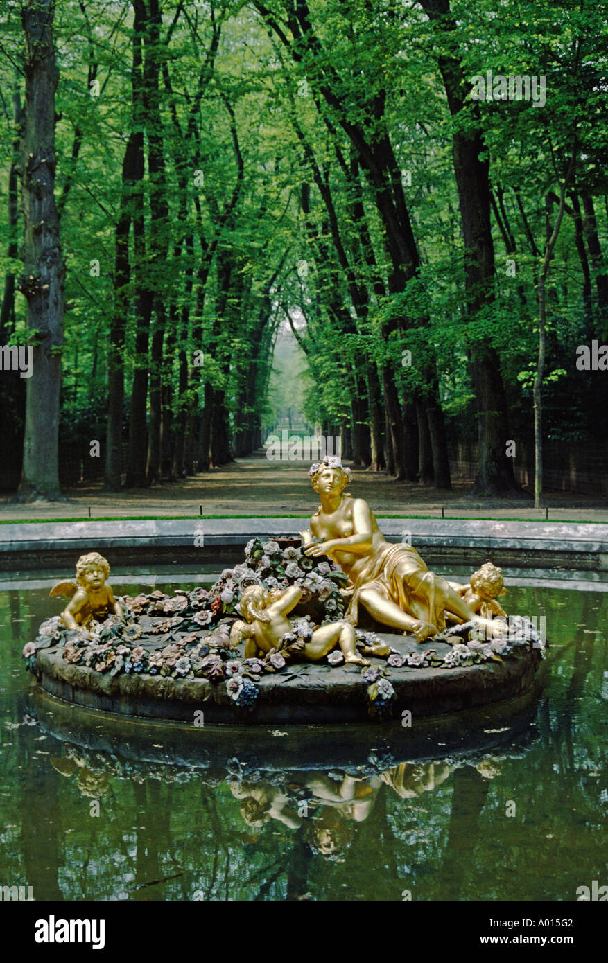 FOUNTAIN with GILDED STATUES in GARDENS of VERSAILLES PALACE