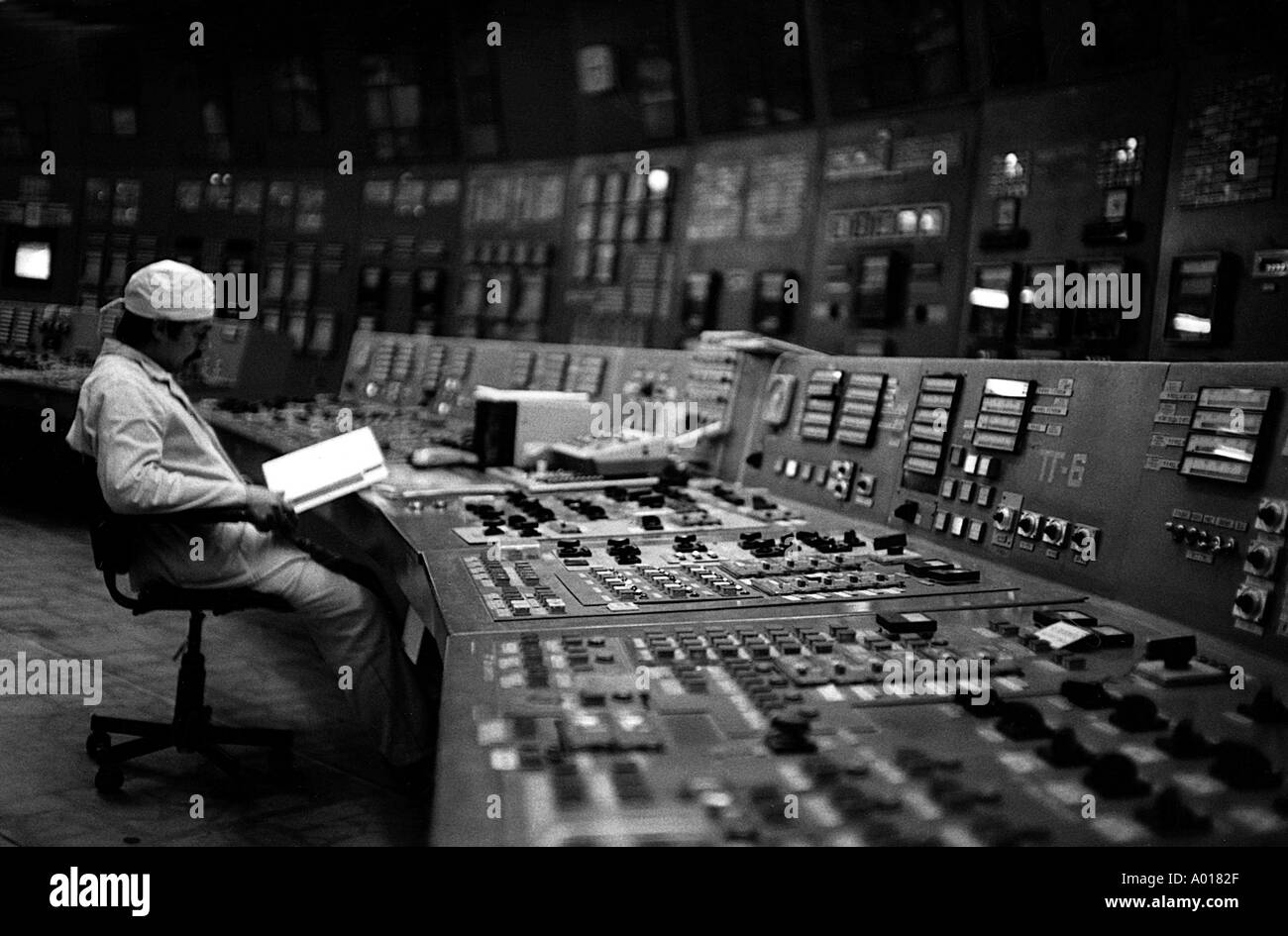 Man sitting at controls of Tschernobyl Nuclear Reactor  Chernobyl Kiev Ukraine Russia - Stock Image