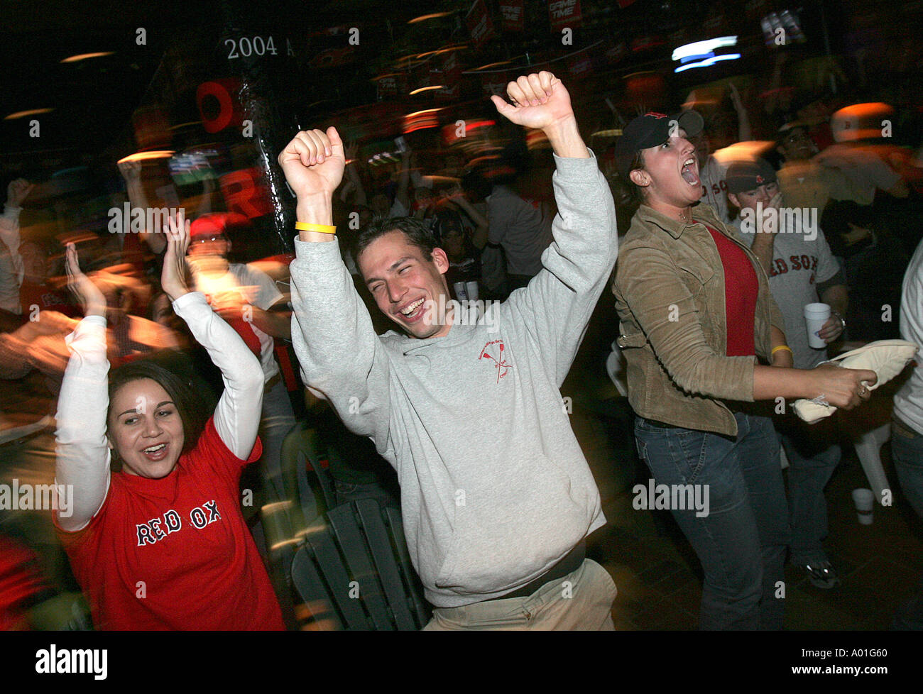 Rowdy Red Sox baseball fans celebrate a win - Stock Image