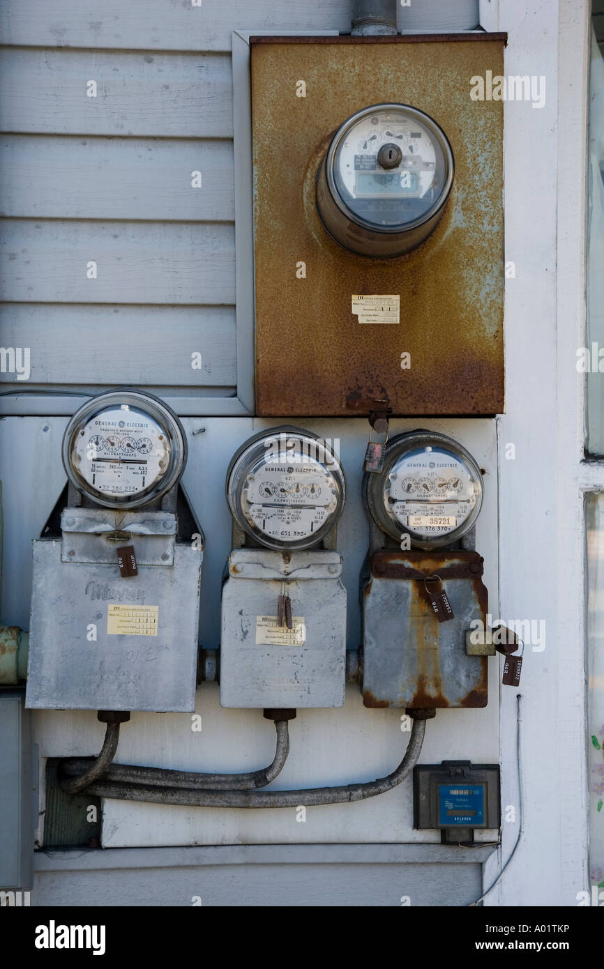 Electric meters on the side of a small building - Stock Image