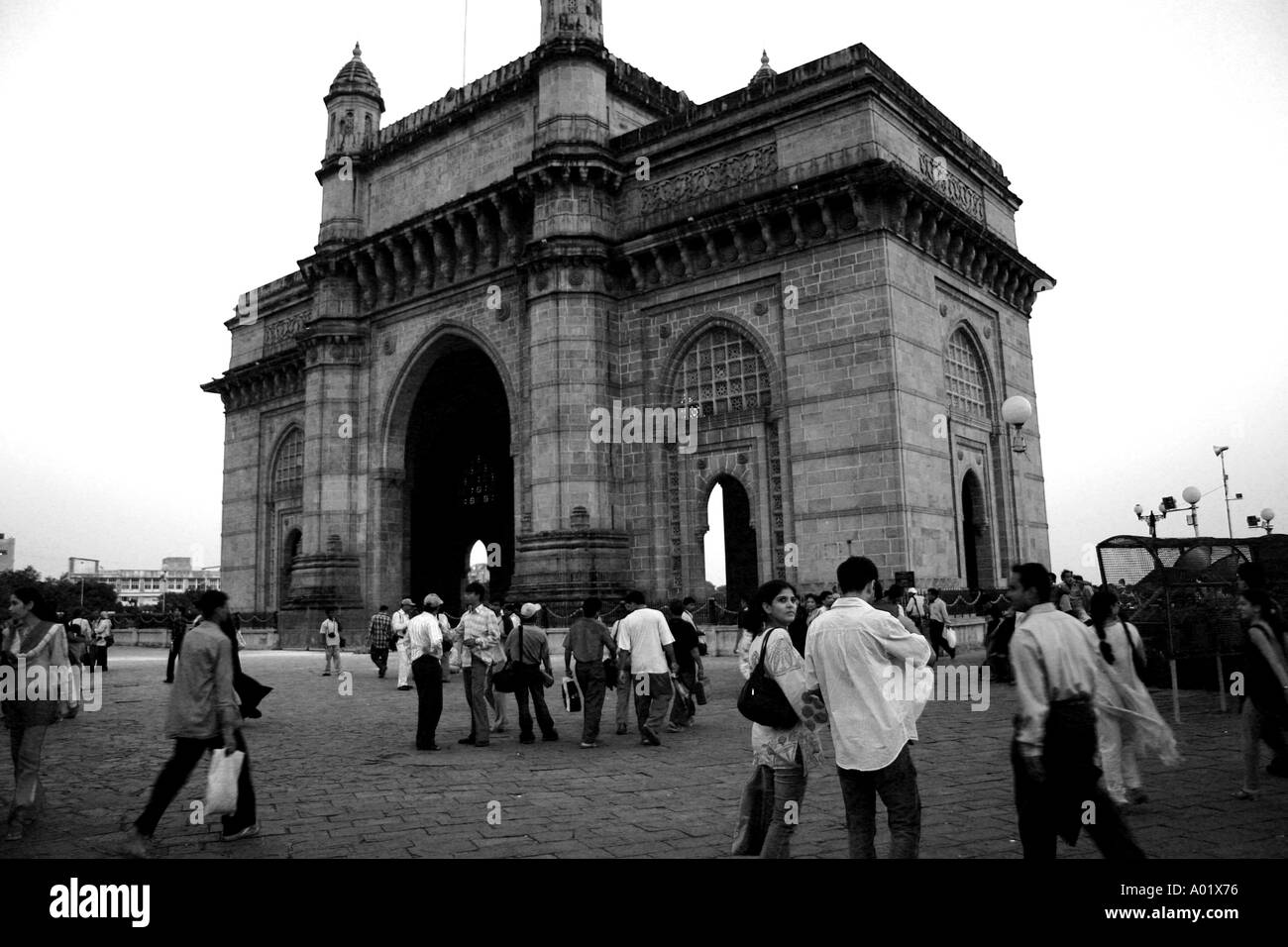 Gateway of India people strolling in the evening Bombay now Mumbai Maharastra India - Stock Image