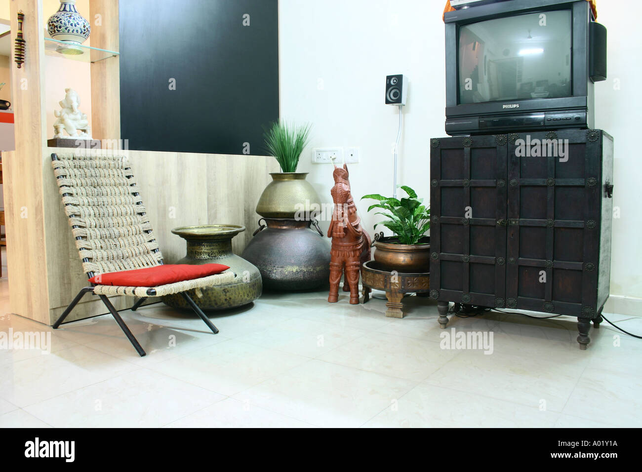 Interior Of Urban Indian Living Room Plastic Cane Chair Red Cushion