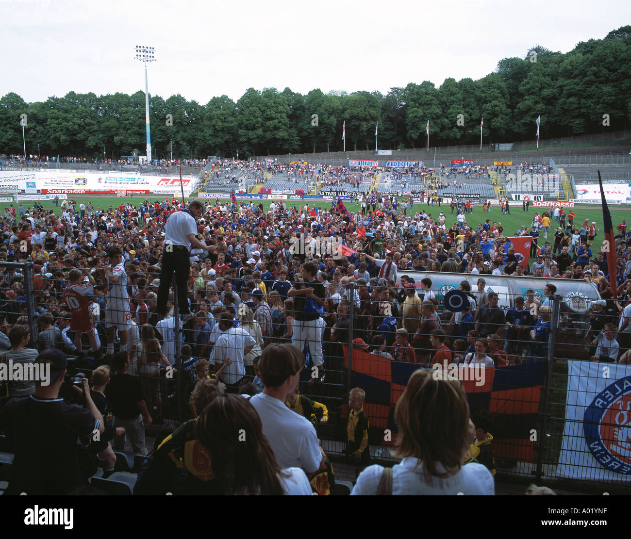 football, Regionalliga North, 2003/2004, SV Wuppertal versus Werder Bremen (A) 1:0, Stadium Am Zoo, spectators, fans, fans in front auf the grandstand, fans celebrating their team and the end of the saison - Stock Image