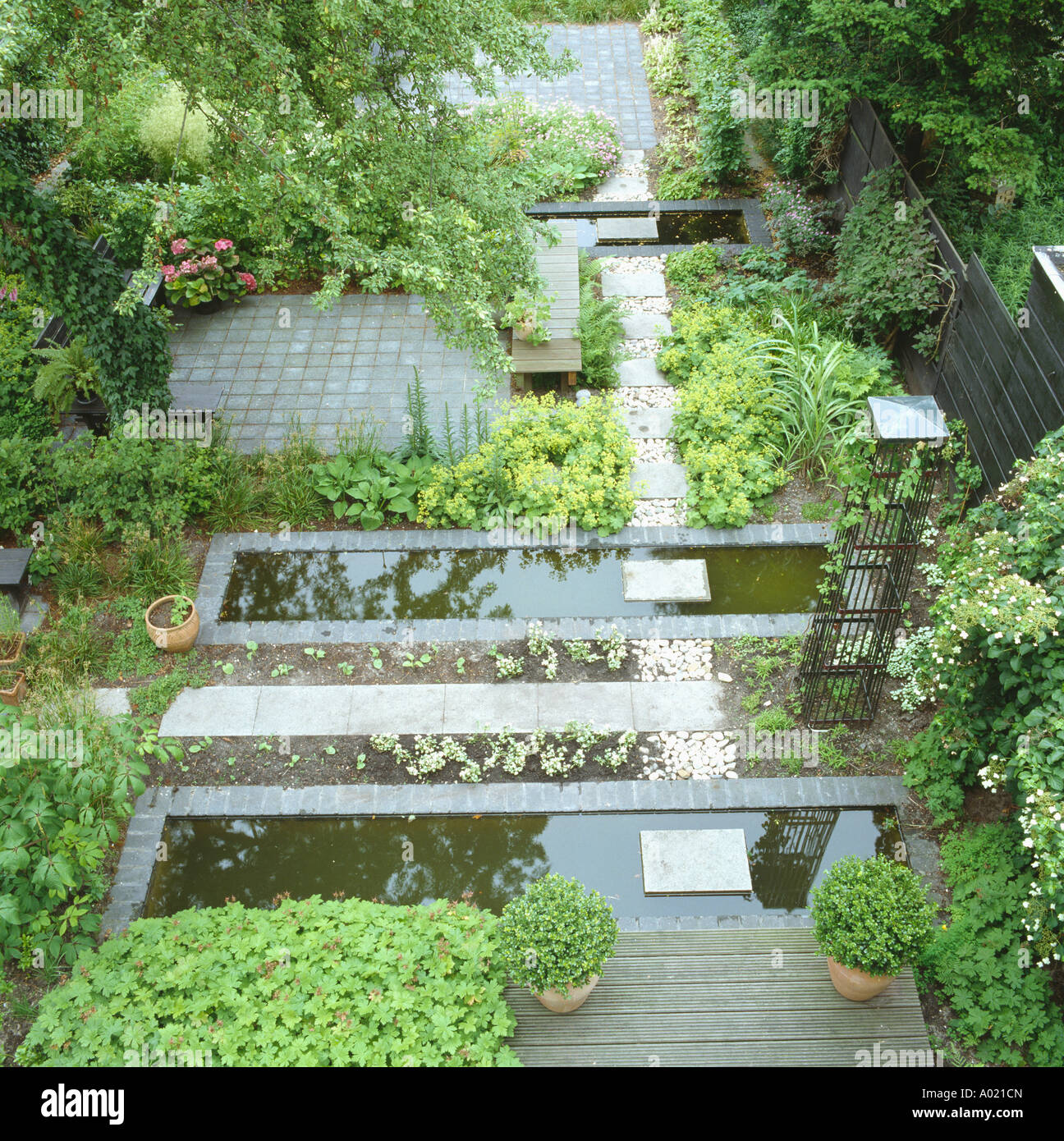 Beau Aerial View Of Paved Garden With Rectangular Ponds And Small ...