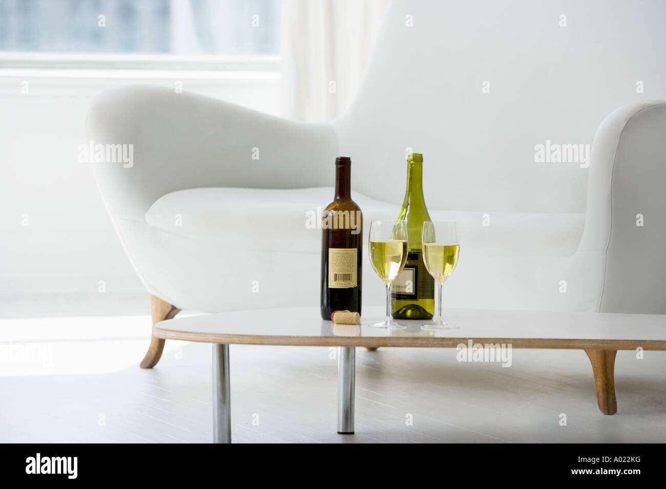 Enjoyable Wine Glasses And Bottles On Coffee Table In Living Room Alphanode Cool Chair Designs And Ideas Alphanodeonline