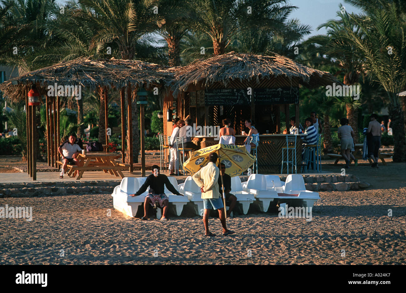 Egyptian staff at the coastal resort of Nuweiba looking after the beach area and watersports equipment Egypt - Stock Image