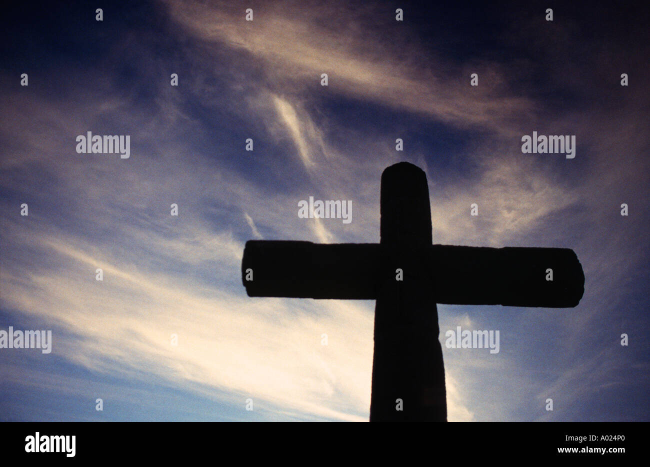 Large stone cross silhouetted against a moody sky Santiago Atitlan on the shores of Lake Atitlan Guatemala - Stock Image