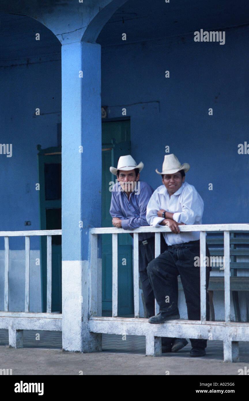Two Ixil Maya men in Western Ladino style dress at the municipal building in Cotzal Guatemala - Stock Image