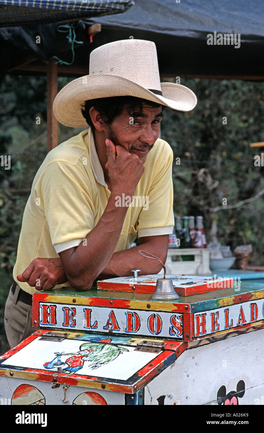 Portrait of an itinerant ice cream vendor at his cart San Martin Jilotepeque Guatemala Central America - Stock Image