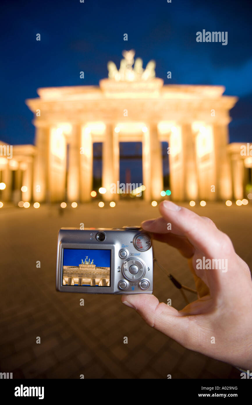 Germany Berlin The Brandenburg Gate Tourist taking a photograph with a digital camera - Stock Image