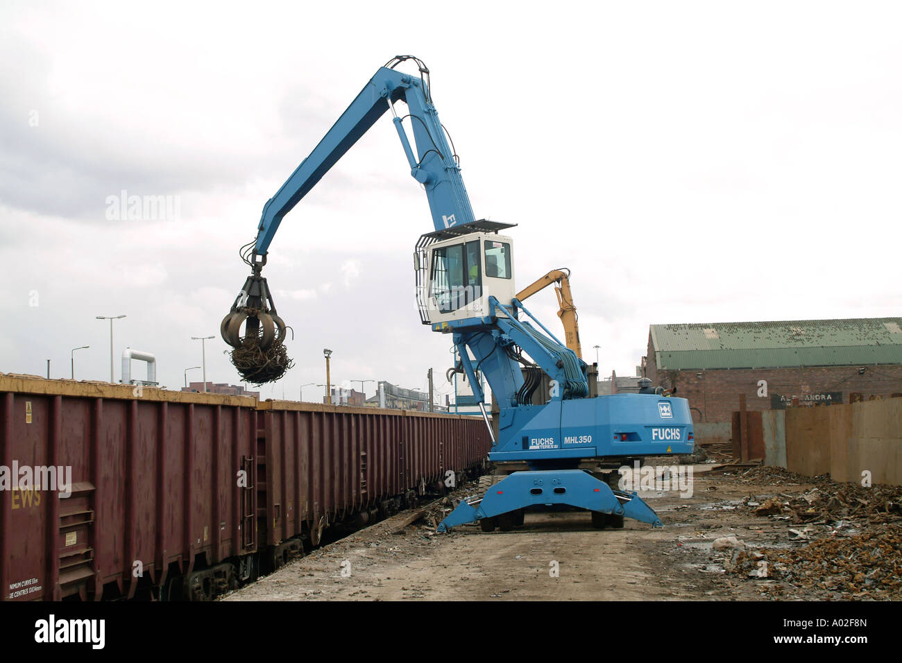 Fuchs MHL 350 loader unloading scrap metal from a train in the uk Stock Photo