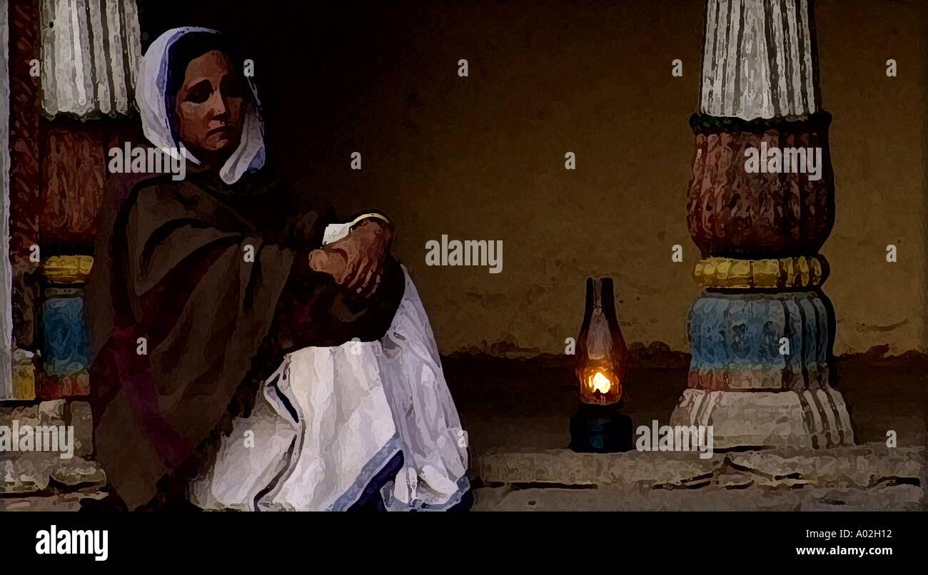 indian women sitting with kerosene lamp - Stock Image