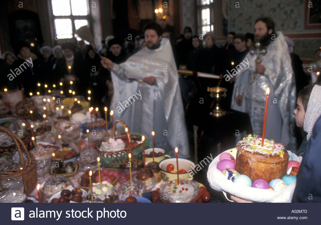 A russian orthodox priest blessing the easter gifts stock photo a russian orthodox priest blessing the easter gifts negle Images