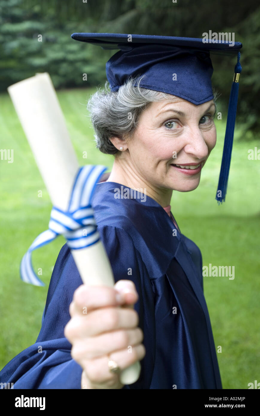 Senior woman college graduate with diploma - Stock Image