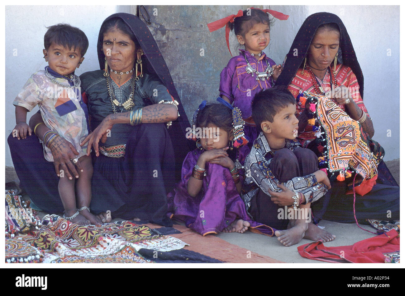 Rabari Wanan with children selling their embroidery to tourist Kachchh region of Gujurat 1996 - Stock Image