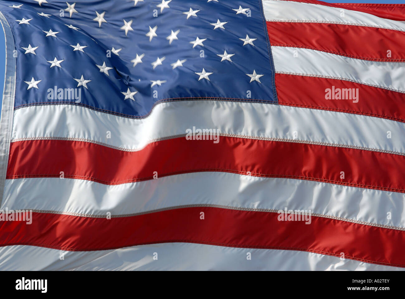 American Flag blowing in wind - Stock Image