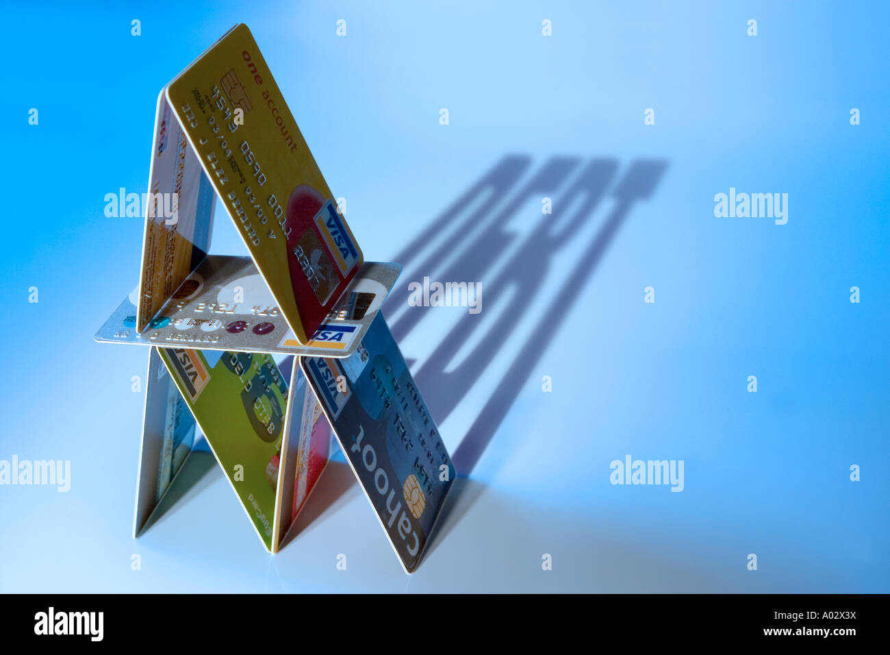 House of credit cards with debt shadow - Stock Image