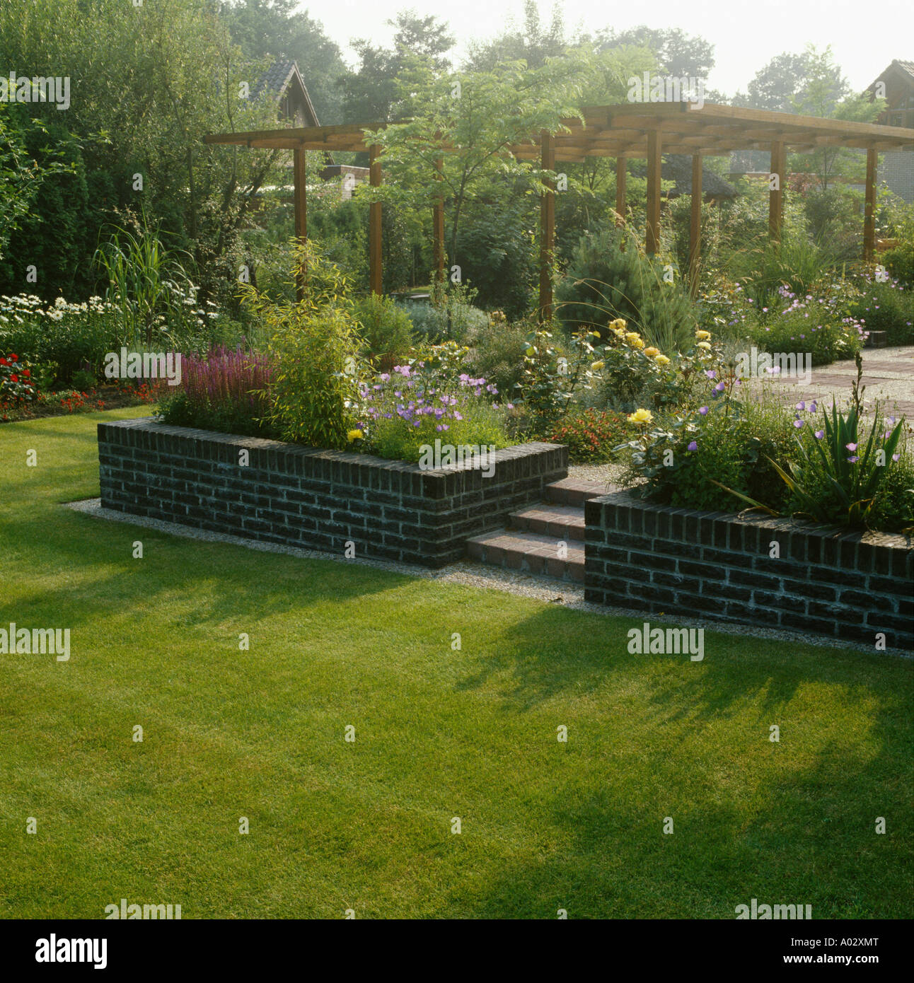Suburban Lawn Garden: View From The Lawn Of A Suburban Garden Over Raised Beds
