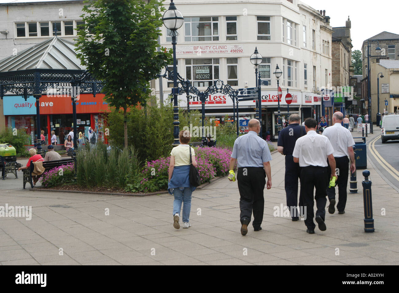 Pedestrians walking through the centre of the town of Dewsbury in England - Stock Image