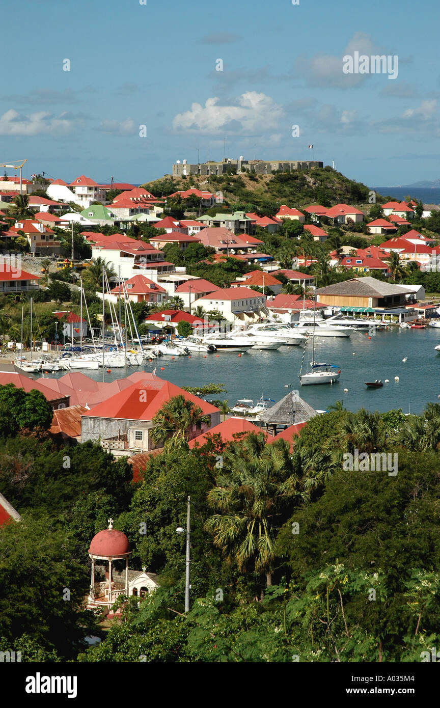 Saint Barth St Barts Gustavia Harbor fort overlooking the city buildings orange roofs, trees mountains - Stock Image
