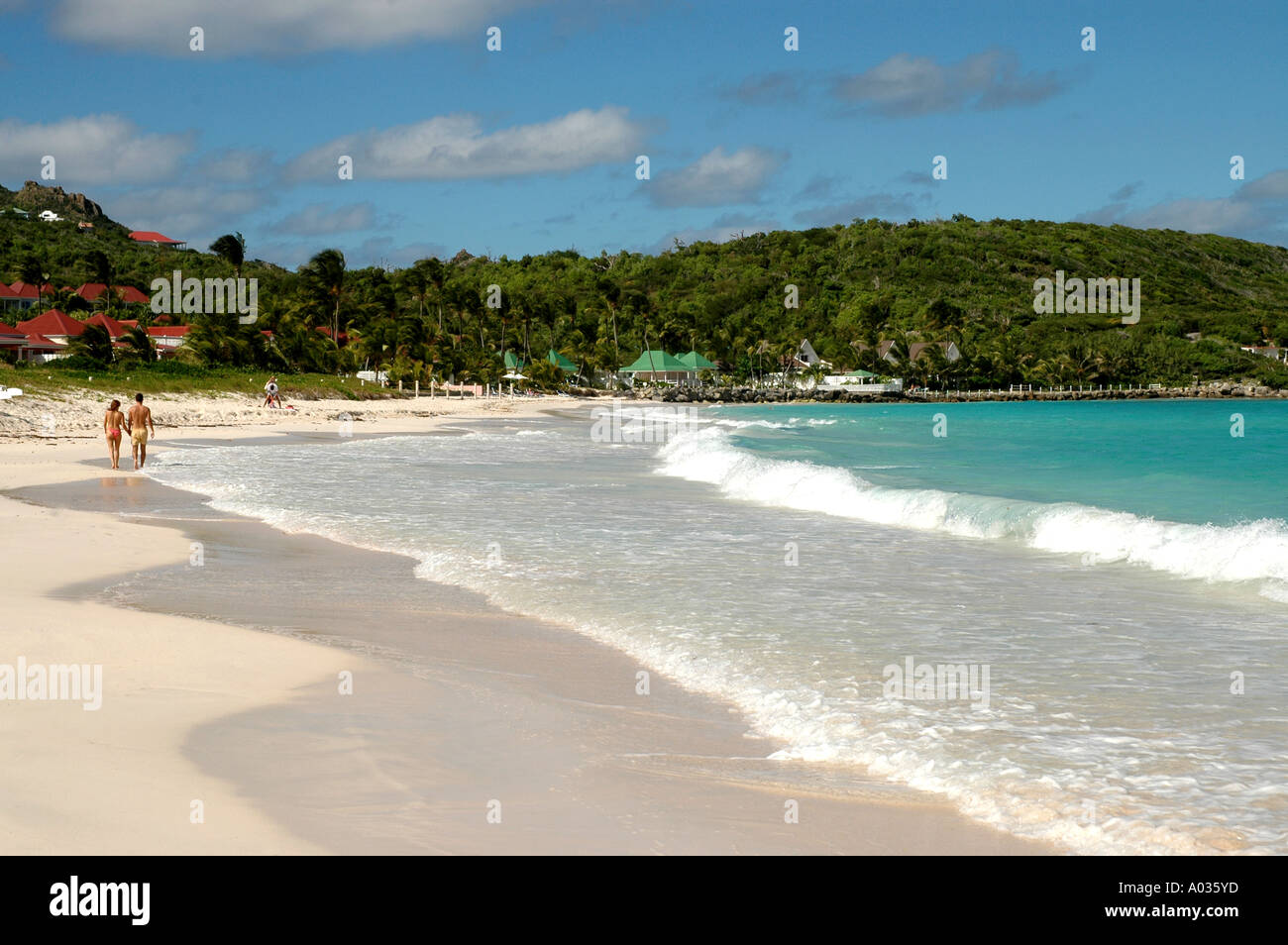 Couple walking beach at  Saint Barth  st jeans beach St Barts st bart saint barthelemy st barts - Stock Image