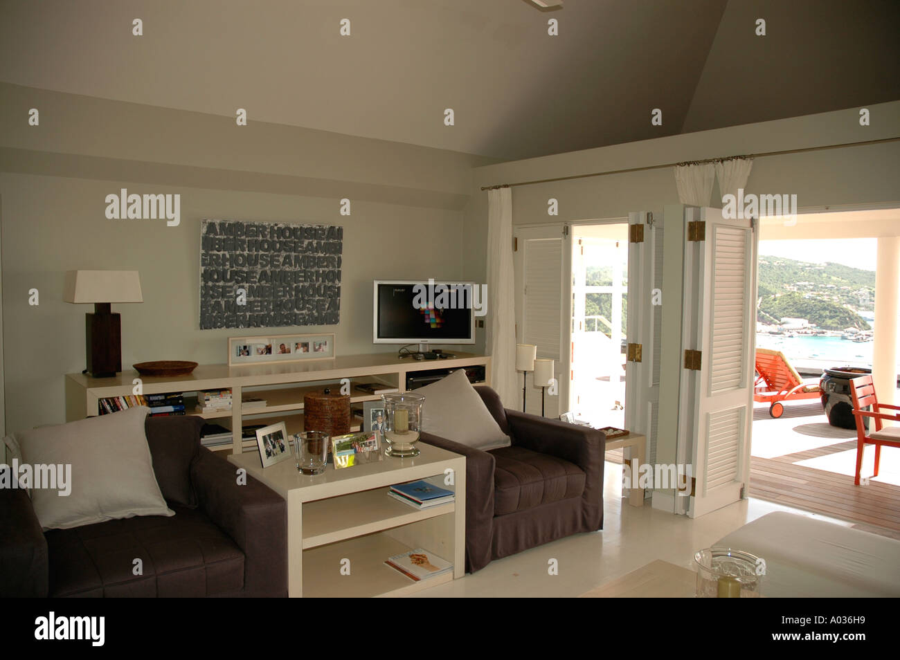 Saint Barth  St Barts Private Villa living room showing bright outdoors - Stock Image