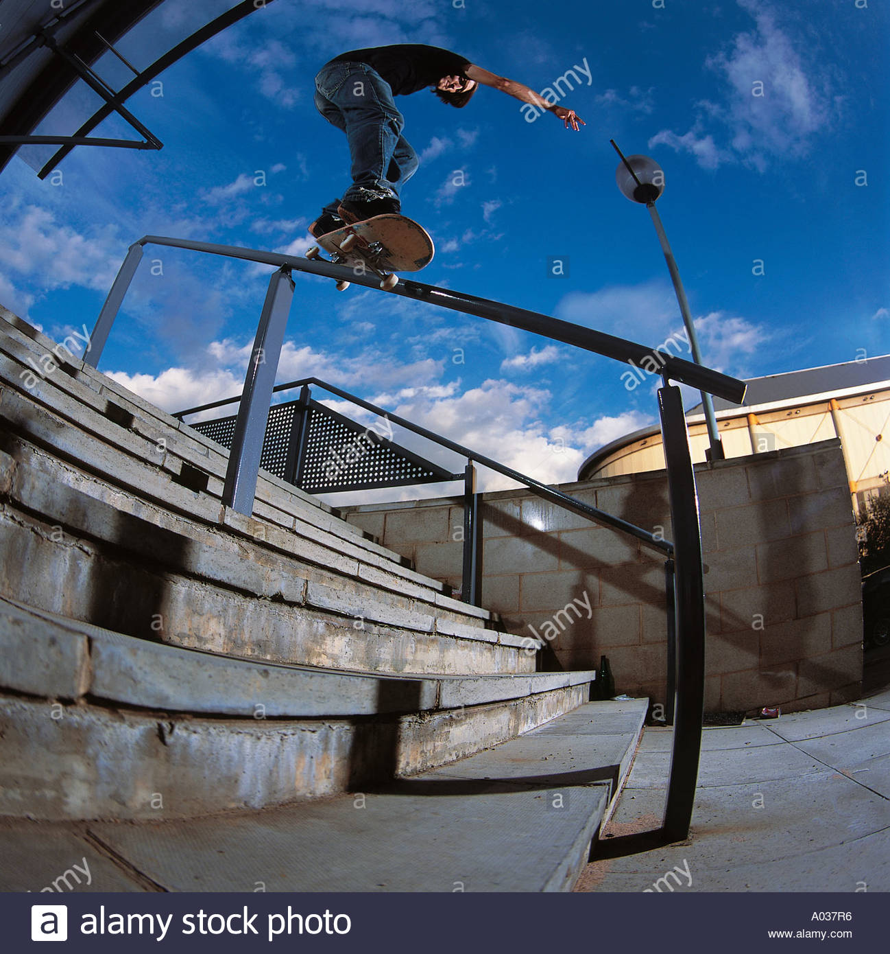 Skateboarder Performs Grind on Handrail,  England - Stock Image