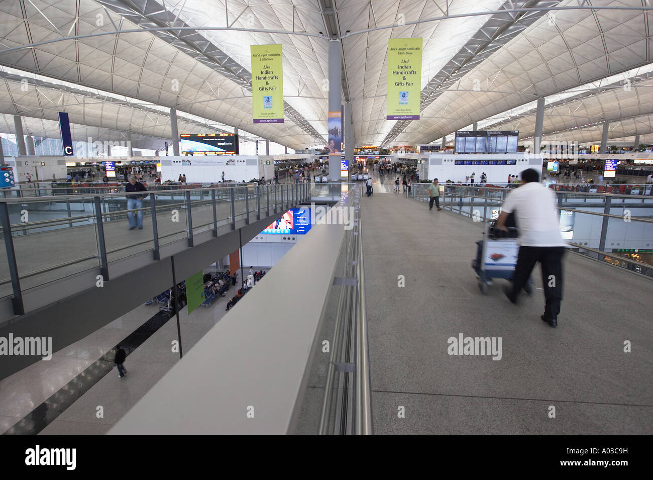 Male Passenger Pushing Trolley In Hong Kong International Airport - Stock Image