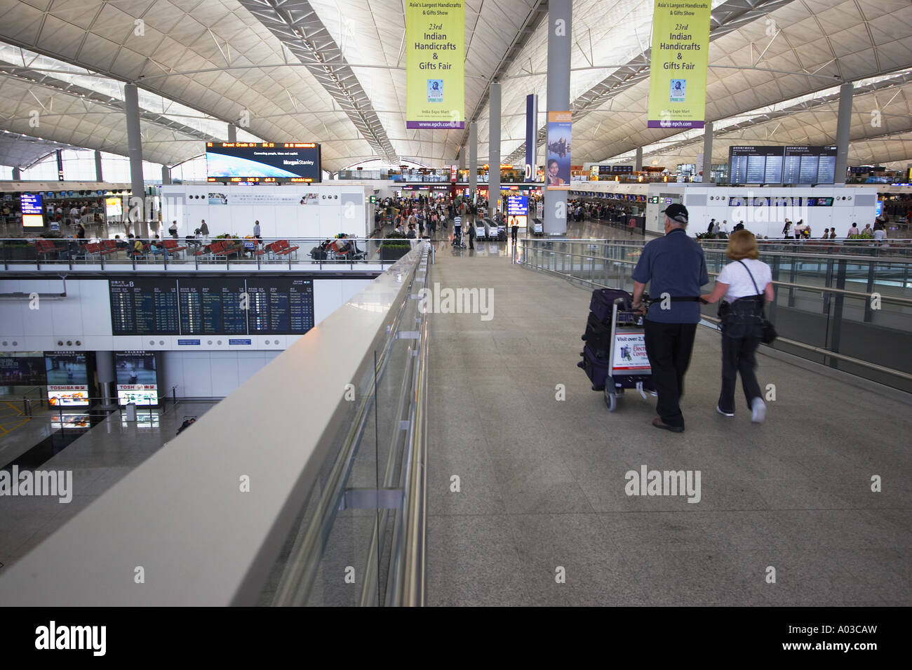 Passengers Walking Into Hong Kong International Airport - Stock Image
