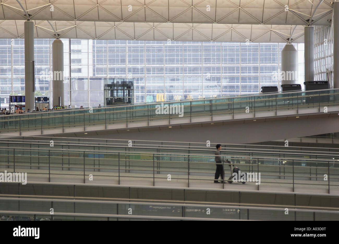 Passenger Walking Along Ramp At Hong Kong International Airport - Stock Image