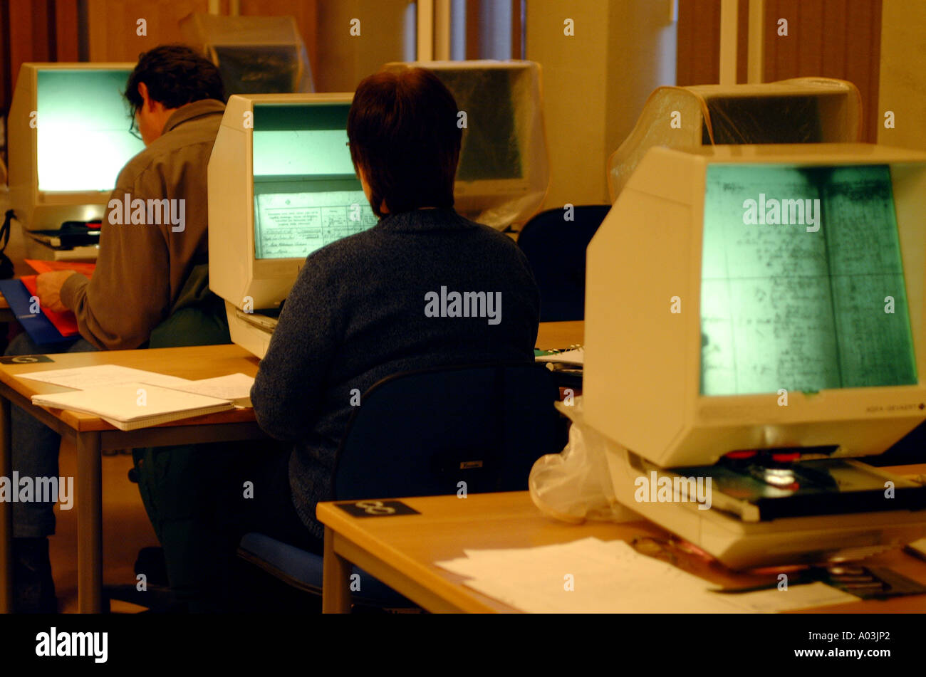 people using microfilms searching device - Stock Image