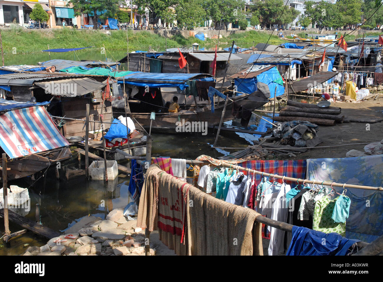 Poor Hue people live in Sampans settlements located on the shores of a Canal leading to the Perfume river Vietnam - Stock Image