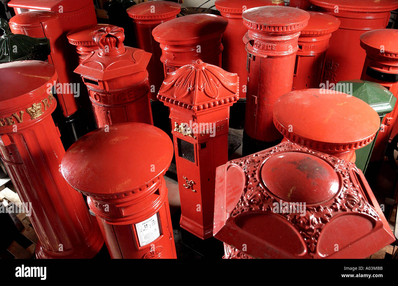 Historic pillar boxes in storage. - Stock Image